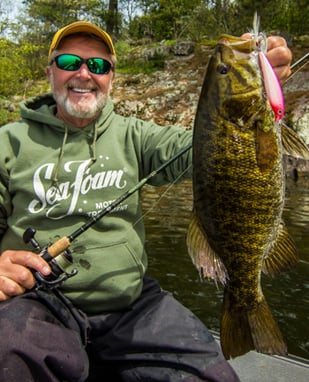 Al Linder with Smallmouth Bass using Marine Pro Fuel Treatment in his Marine outboard motor