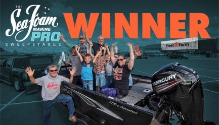 Sea Foam Marine Pro Sweepstakes Winner in front of Fleet Farm