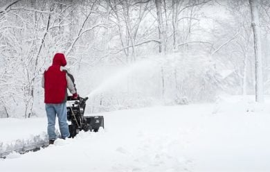 Guy Snow Blowing